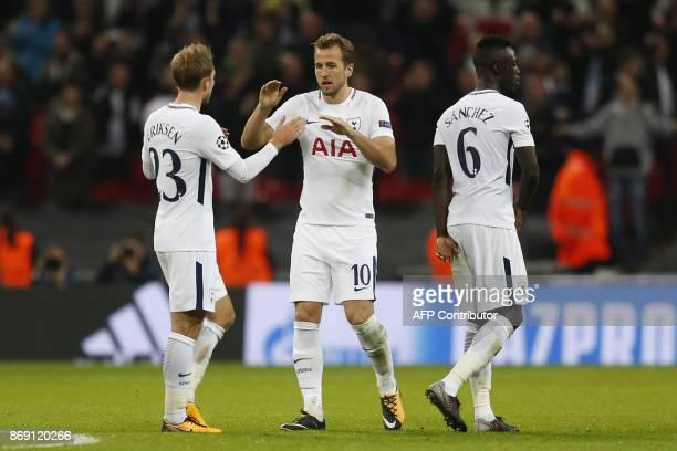 Tottenham Hotspur's Danish midfielder Christian Eriksen Tottenham Hotspur's English striker Harry Kane and Tottenham Hotspur's Colombian defender...