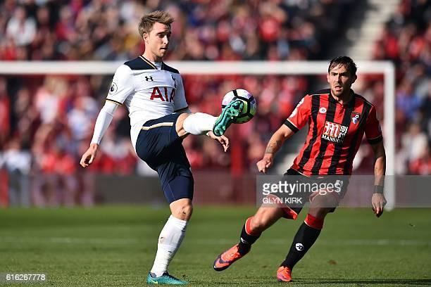 Tottenham Hotspur's Danish midfielder Christian Eriksen vies with Bournemouth's English midfielder Charlie Daniels during the English Premier League...
