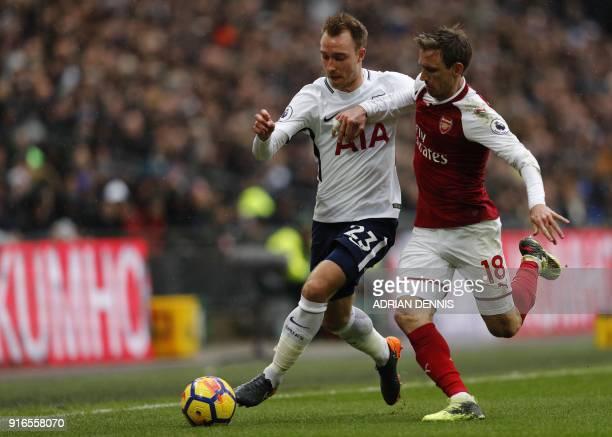 Tottenham Hotspur's Danish midfielder Christian Eriksen vies with Arsenal's Spanish defender Nacho Monreal during the English Premier League football...