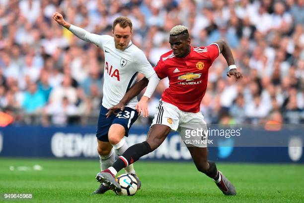 Tottenham Hotspur's Danish midfielder Christian Eriksen vies with Manchester United's French midfielder Paul Pogba during the English FA Cup...