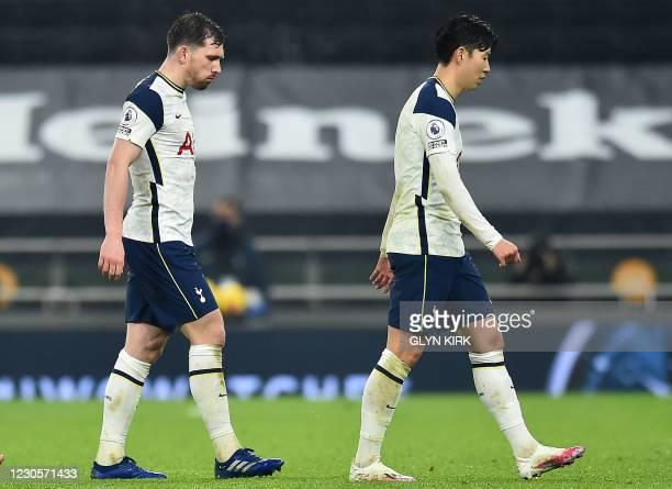 Tottenham Hotspur's Danish midfielder Pierre-Emile Hojbjerg and Tottenham Hotspur's South Korean striker Son Heung-Min walk off the pitch after the...