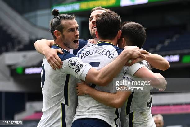 Tottenham Hotspur's Danish midfielder Pierre-Emile Hojbjerg celebrates with teammates after scoring their second goal during the English Premier...