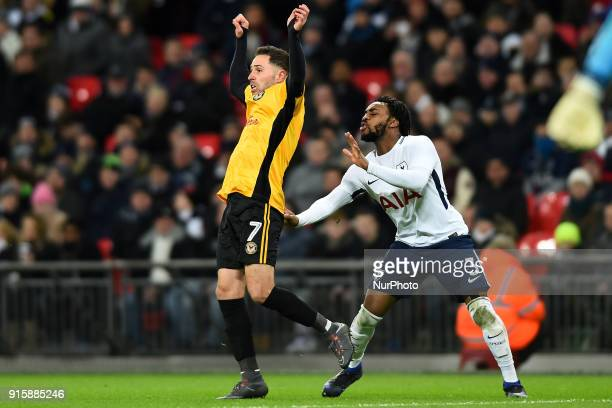 Tottenham Hotspur's Danny Rose gives Robbie Willmott of Newport County a little tug during the FA Cup Fourth Round replay match between Tottenham...