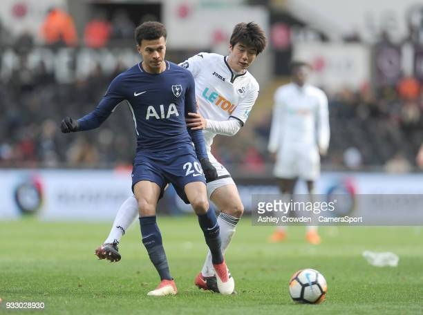 Tottenham Hotspur's Dele Alli battles with Swansea City's Ki SungYueng during the Emirates FA Cup QuarterFinal between Swansea City and Tottenham...