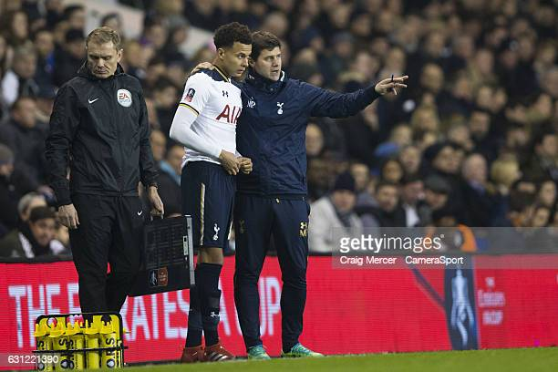 Tottenham Hotspur's Dele Alli gets instructions from Tottenham Hotspur manager Mauricio Pochettino as he prepares to come on during the Emirates FA...