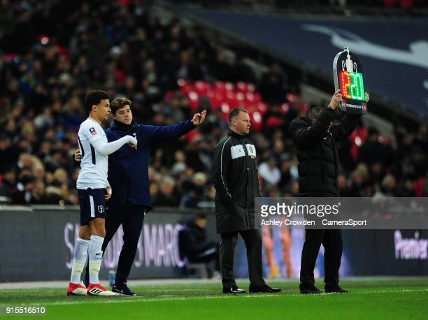 Tottenham Hotspur's Dele Alli gets instructions from Tottenham Hotspur manager Mauricio Pochettino during the The Emirates FA Cup Fourth Round Replay...