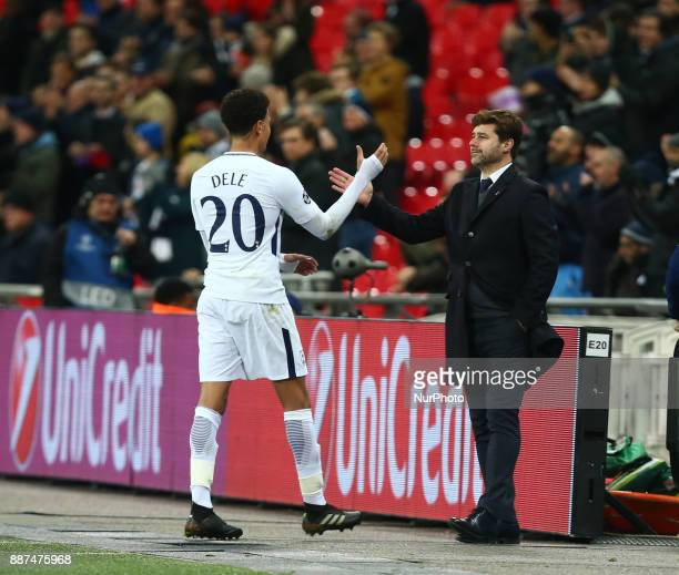 Tottenham Hotspur's Dele Alli shanks hands with Tottenham Hotspur manager Mauricio Pochettino during the Champions League Group G match between...