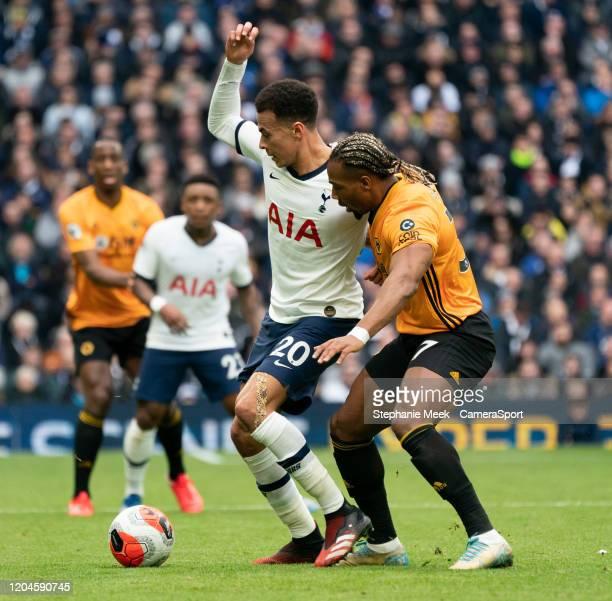 Tottenham Hotspur's Dele Alli under pressure from Wolverhampton Wanderers' Adama Traore during the Premier League match between Tottenham Hotspur and...
