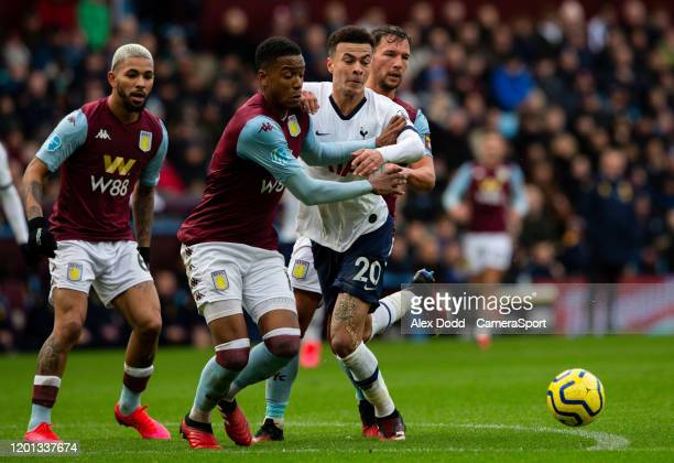 Tottenham Hotspur's Dele Alli vies for possession with Aston Villa's Ezri Konsa and Danny Drinkwater during the Premier League match between Aston...