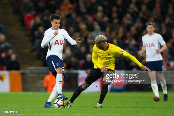 Tottenham Hotspur's Dele Alli vies for possession with Watford's Etienne Capoue during the Premier League match between Tottenham Hotspur and Watford...