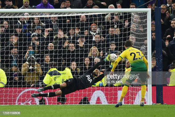 Tottenham Hotspur's Dutch goalkeeper Michel Vorm makes a save on Norwich City's Scottish midfielder Kenny McLean's penalty during the English FA Cup...