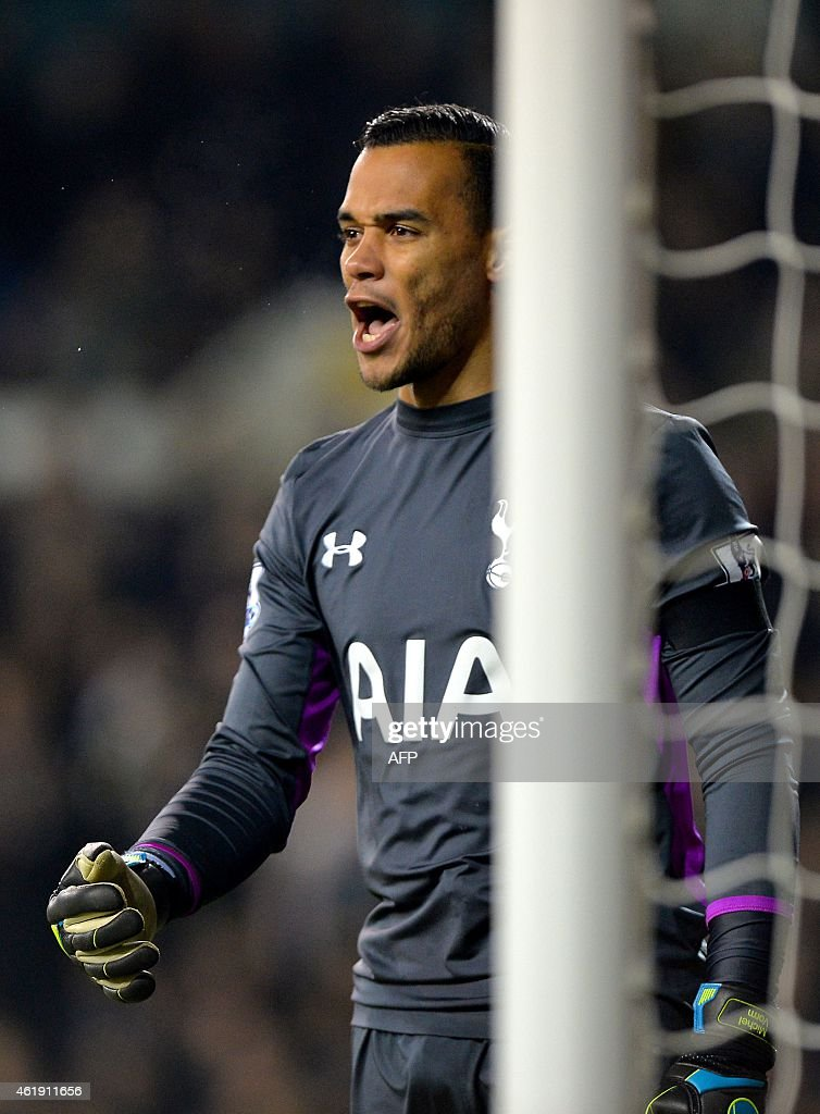 Tottenham Hotspur's Dutch goalkeeper Michel Vorm mans hit post during the English League Cup semi-final first leg football match between Tottenham Hotspur and Sheffield United at White Hart Lane in London, on January 21, 2015.