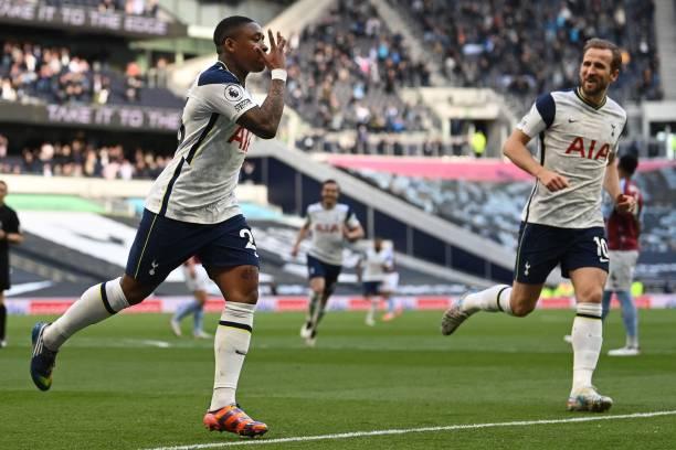 Tottenham Hotspur's Dutch midfielder Steven Bergwijn celebrates scoring his team's first goal with Tottenham Hotspur's English striker Harry Kane...