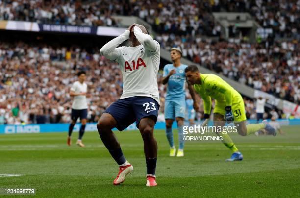 Tottenham Hotspur's Dutch midfielder Steven Bergwijn reacts after failing to score during the English Premier League football match between Tottenham...