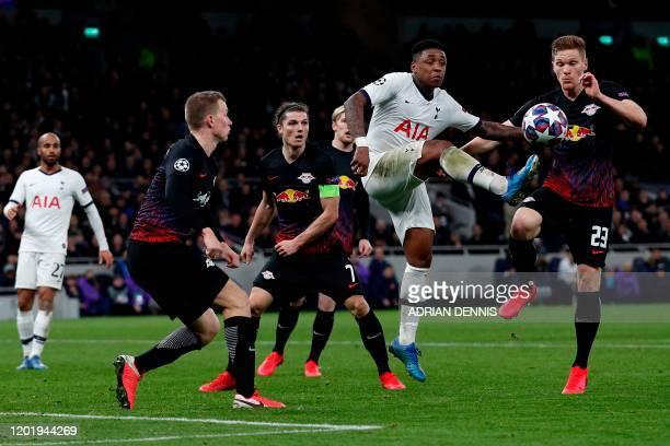 Tottenham Hotspur's Dutch midfielder Steven Bergwijn vie swith RB Leipzig's German defender Marcel Halstenberg during the UEFA Champions League round...