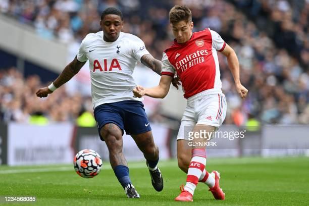 Tottenham Hotspur's Dutch midfielder Steven Bergwijn vies with Arsenal's Scottish defender Kieran Tierney during the pre-season friendly football...