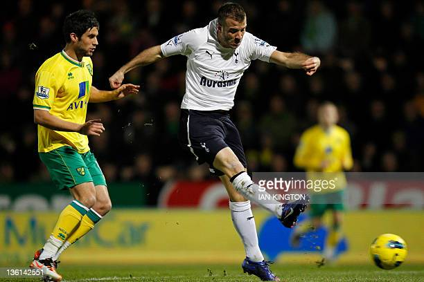 Tottenham Hotspur's Dutch player Rafael van der Vaart attempts a shot but doesn't score watched by Norwich City's Russell Martin during an English...