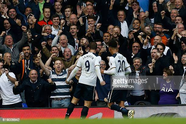 Tottenham Hotspur's Dutch striker Vincent Janssen celebrates with Tottenham Hotspur's English midfielder Dele Alli after scoring the opening goal...