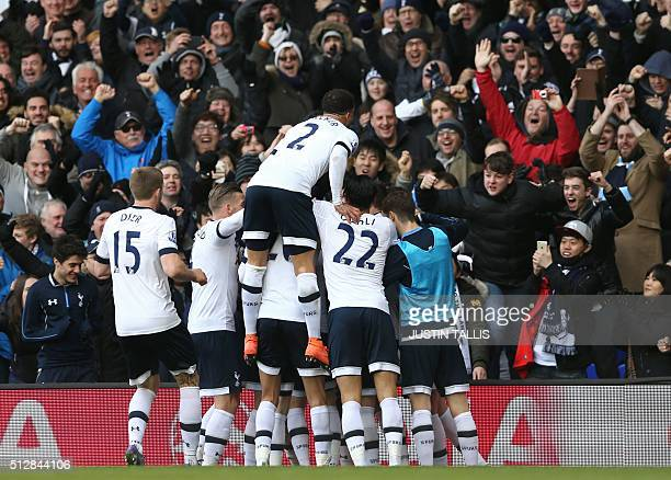 Tottenham Hotspur's English defender Danny Rose celebrates with teammates after scoring their second goal during the English Premier League football...