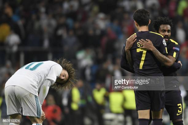 Tottenham Hotspur's English defender Danny Rose celebrates with Tottenham Hotspur's South Korean striker Son HeungMin after the UEFA Champions League...