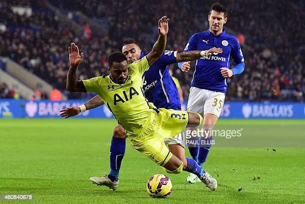 Tottenham Hotspur's English defender Danny Rose is tackled by Leicester City's English defender Danny Simpson and Leicester City's English striker...