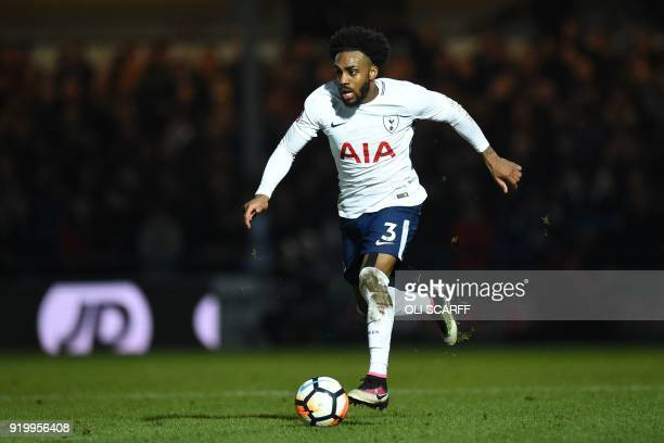 Tottenham Hotspur's English defender Danny Rose runs with the ball during the English FA Cup fifth round football match between Rochdale and...