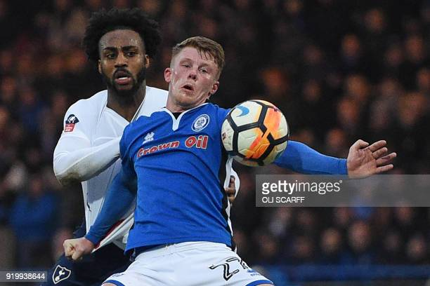 Tottenham Hotspur's English defender Danny Rose vies with Rochdale's English midfielder Andy Cannon during the English FA Cup fifth round football...