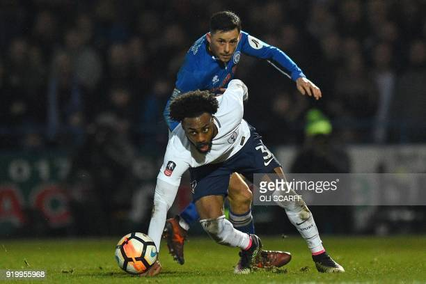 Tottenham Hotspur's English defender Danny Rose vies with Rochdale's English striker Ian Henderson during the English FA Cup fifth round football...