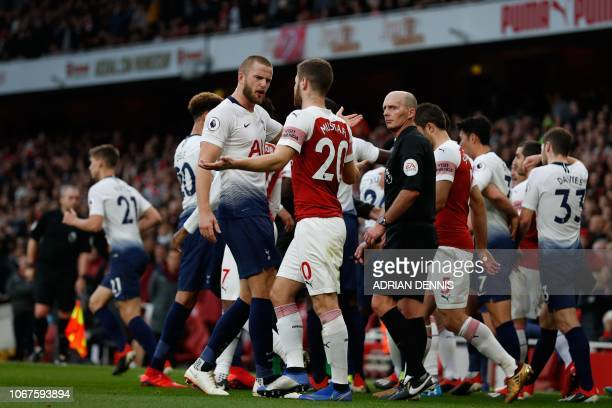 Tottenham Hotspur's English defender Eric Dier and Arsenal's German defender Shkodran Mustafi clash after Dier celebrates his equalizer during the...