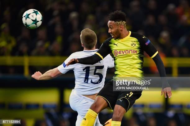 Tottenham Hotspur's English defender Eric Dier and Dortmund's Gabonese forward PierreEmerick Aubameyang vie for the ball during the UEFA Champions...