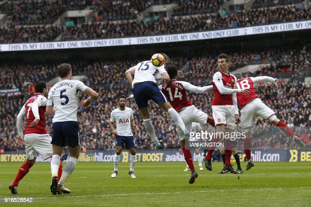 Tottenham Hotspur's English defender Eric Dier goes up for a header during the English Premier League football match between Tottenham Hotspur and...