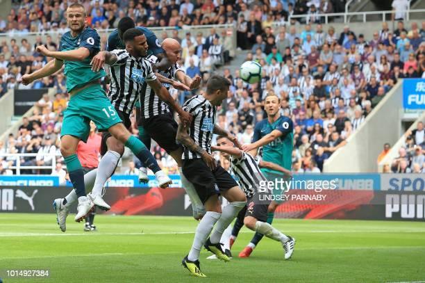 Tottenham Hotspur's English defender Eric Dier heads the ball towards goal for Tottenham Hotspur's Belgian defender Jan Vertonghen to score the...
