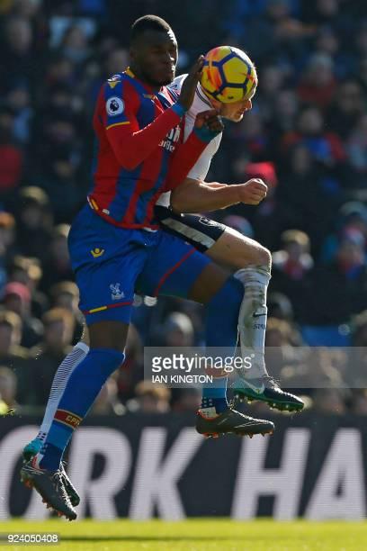 Tottenham Hotspur's English defender Eric Dier vies with Crystal Palace's Zaireborn Belgian striker Christian Benteke during the English Premier...