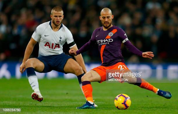 Tottenham Hotspur's English defender Eric Dier vies with Manchester City's Spanish midfielder David Silva during the English Premier League football...