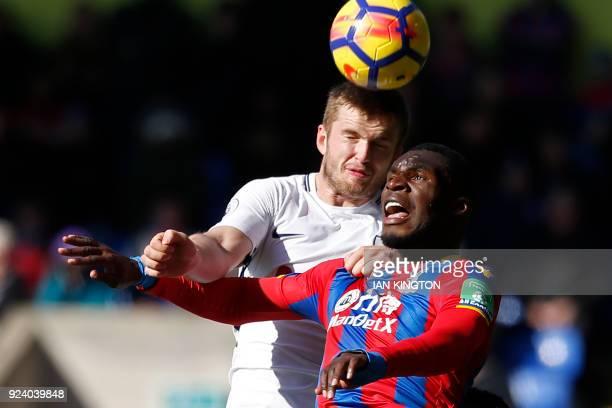Tottenham Hotspur's English defender Eric Dier wins a header from Crystal Palace's Zaireborn Belgian striker Christian Benteke during the English...