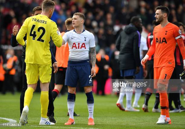Tottenham Hotspur's English defender Kieran Trippier and Tottenham Hotspur's French goalkeeper Hugo Lloris congratulate Bournemouth's English...