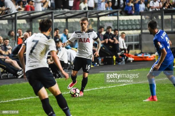 Tottenham Hotspur's English defender Kieran Trippier controls the ball during the friendly football match between Tottenham Hotspurs and Kitchee FC...