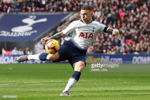 Tottenham Hotspur's English defender Kieran Trippier shoots but fails to score during the English Premier League football match between Tottenham...