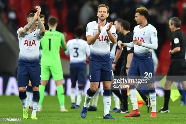 Tottenham Hotspur's English defender Kieran Trippier Tottenham Hotspur's English striker Harry Kane and Tottenham Hotspur's English midfielder Dele...
