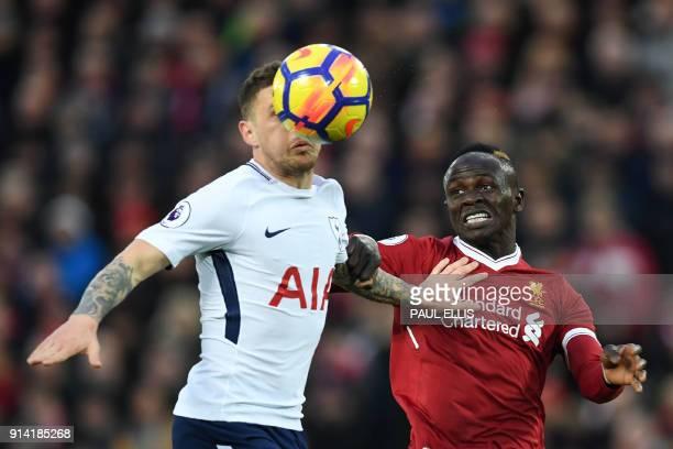 TOPSHOT Tottenham Hotspur's English defender Kieran Trippier vies with Liverpool's Senegalese midfielder Sadio Mane during the English Premier League...