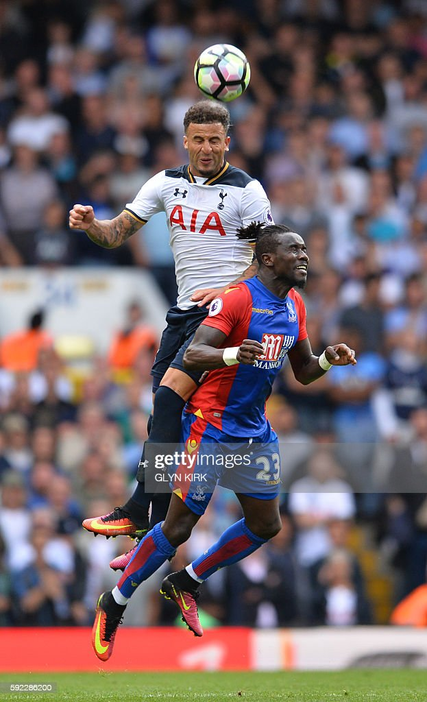 Tottenham Hotspur's English defender Kyle Walker (L) vies with Crystal Palace's Senegalese defender Pape Souare during the English Premier League football match between Tottenham Hotspur and Crystal Palace at White Hart Lane in London, on August 20, 2016. Tottenham won the game 1-0. / AFP / Glyn KIRK / RESTRICTED TO EDITORIAL USE. No use with unauthorized audio, video, data, fixture lists, club/league logos or 'live' services. Online in-match use limited to 75 images, no video emulation. No use in betting, games or single club/league/player publications. /