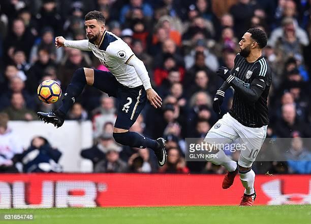 Tottenham Hotspur's English defender Kyle Walker vies with West Bromwich Albion's Englishborn Scottish midfielder Matt Phillips during the English...