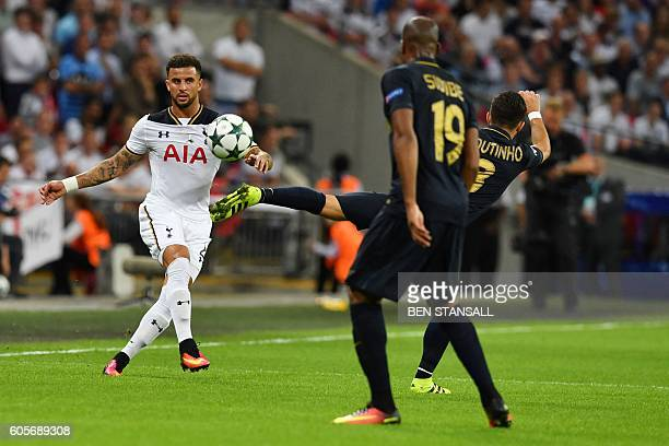 Tottenham Hotspur's English defender Kyle Walkerb crosses the ball past Monaco's Portuguese midfielder Joao Moutinho during the UEFA Champions League...