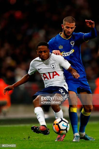 Tottenham Hotspur's English defender Kyle WalkerPeters vies with AFC Wimbledon's English midfielder George Francomb during the English FA Cup third...