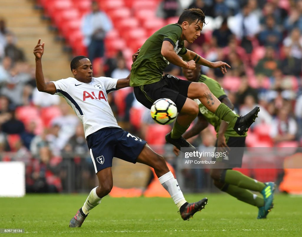 Tottenham Hotspur's English defender Kyle Walker-Peters (L) vies with Juventus' Argentinian striker Paulo Dybala during the pre-season friendly football match between Tottenham Hotspur and Juventus at Wembley stadium in London on August 5, 2017. / AFP PHOTO / OLLY GREENWOOD / RESTRICTED TO EDITORIAL USE. No use with unauthorized audio, video, data, fixture lists, club/league logos or 'live' services. Online in-match use limited to 75 images, no video emulation. No use in betting, games or single club/league/player publications. /