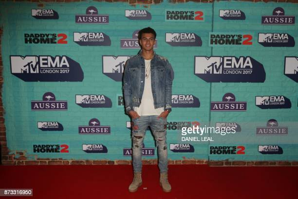 Tottenham Hotspur's English football player Dele Alli poses on the red carpet arriving to attend the 2017 MTV Europe Music Awards at Wembley Arena in...