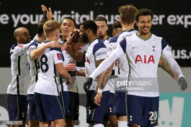 Tottenham Hotspur's English midfielder Alfie Devine celebrates with teammates after scoring their fifth goal during the English FA Cup third round...
