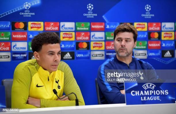 Tottenham Hotspur's English midfielder Dele Alli and Tottenham Hotspur's Argentinian head coach Mauricio Pochettino attend a press conference at...