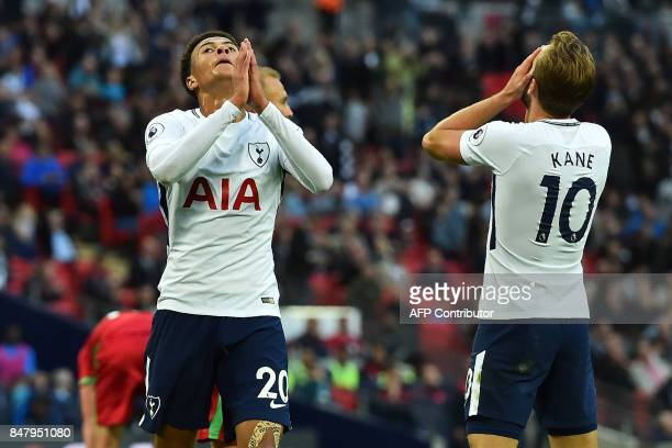 Tottenham Hotspur's English midfielder Dele Alli and Tottenham Hotspur's English striker Harry Kane react to missing a chance during the English...