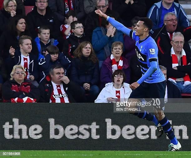 Tottenham Hotspur's English midfielder Dele Alli celebrates after scoring Tottenham's second goal during the English Premier League football match...